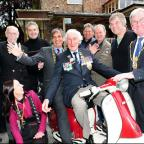 The former Lord Mayor of York, Coun Keith Hyman, right, with Ken Smith of the Normandy Veterans Association, the Sherrif of York and members of York Inset Scooter Club at the cheque presentation at the Walnut Tree