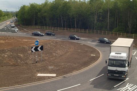 The first vehicles negotiate the new roundabout at Osgodby