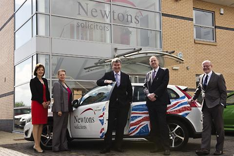 Managing director Chris Newton, behind car door, with new directors, from left, Elizabeth Webb, John Paice and Rob Minors.