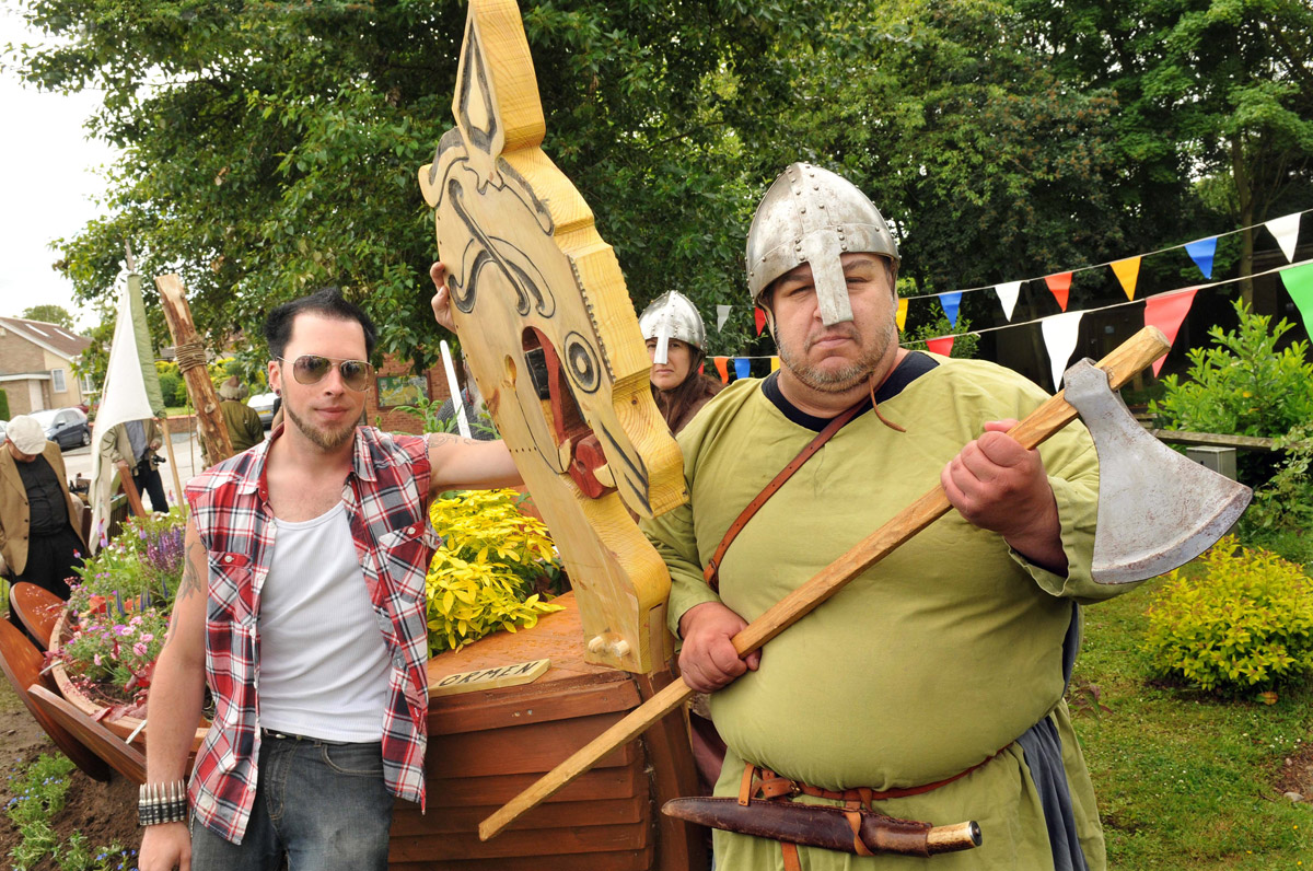 Viking warrior Gyrth and his colleagues from Volsung and Orsheim battle re-enactment groups who helped launch Ormen at Stamford Bridge,  a replica longship built by students at York College with its head carved by joinery student Johnny Hayes