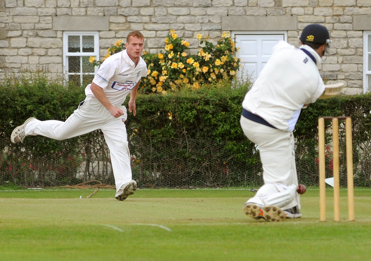 Pickering's Ryan Boyes takes the wicket of Fenner's Paul Scrowston