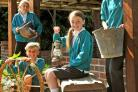 Poppleton Ousebank pupils with some of the items from the school's archaeological dig