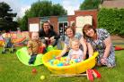 Rich Birks, Sandy Watson and Liz Tomlinson with young visitors Daniel and Imogen Timms, by the bungalow at Yearsley Grove School