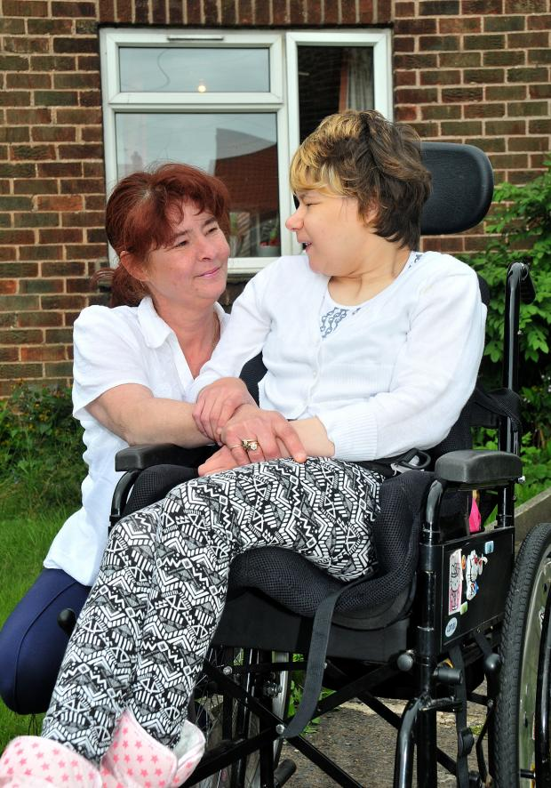 Lisa Evans and her daughter Vicki at the home they fear they will have to leave because of the bedroom tax
