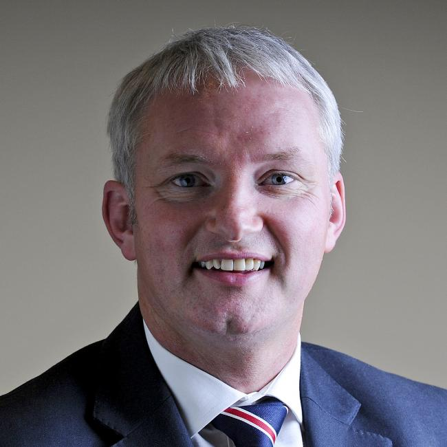 Chris Greenall, managing director of the insurance firm where he started as a teaboy