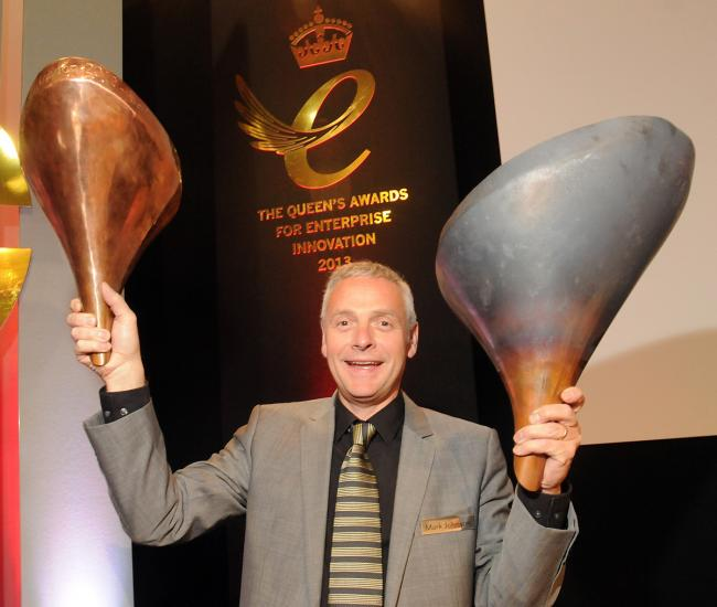 Mark Johnson, chief operating officer of Stage One, with two of the test petals for the London 2012 Olympic Cauldron. Stage One, based at Tockwith, have won the Queen's Award for Enterprise