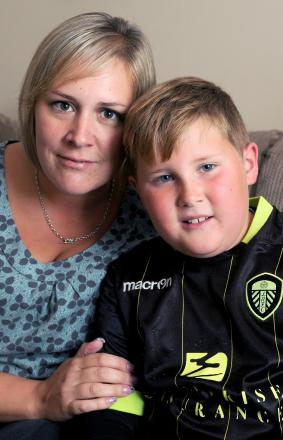 Eight-year-old Ben Foy, who suffers from narcolepsy, with his mum, Lindsey, at their home in Strensall