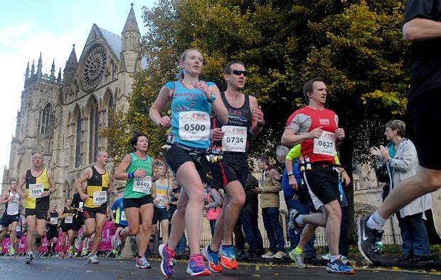 Runners pass the Minster during last year's Yorkshire Marathon