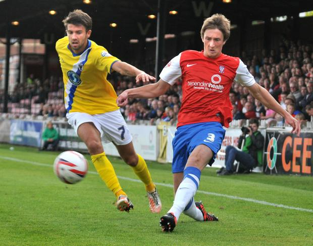 York City loanee Ben Davies fires in a testing cross