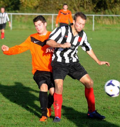 Jimmy Wilmoth, right, was on target for Dunnington as they beat Poppleton United 3-1 in the  York Minster Engineering League premier division