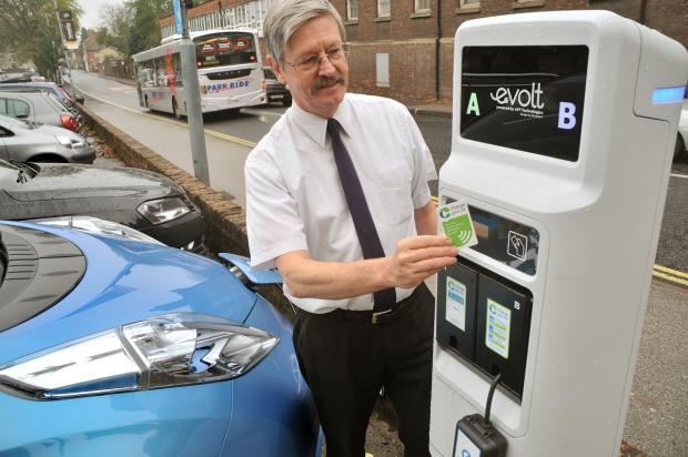 Coun Dave Merrett at the new electric car charging point in Nunnery Lane car park