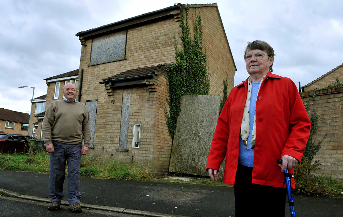 The house in Bradley Drive, Foxwood, which Joyce Hardy and neighbour David Batey say has been attracting       squatters, vandals and fly-tippers