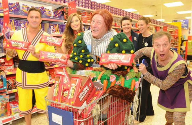 Berwick Kaler picks up his Wagon Wheels from Tesco in Tadcaster Road, ready for the  Theatre Royal pantomine Aladdin, with cast members, from left, A J Powell, Danielle Mullan and Martin Barrass