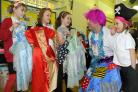 Steve Evans, dressed as Widow Twankey, with young stallholders at Fishergate Primary School's Christmas fair