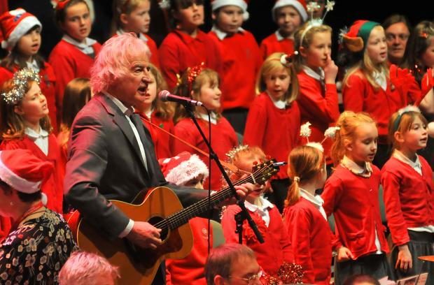 Steve Cassidy leads the children from Headlands Primary School and Yearsley Grove Primary School at last year's community carol concert at the Barbican