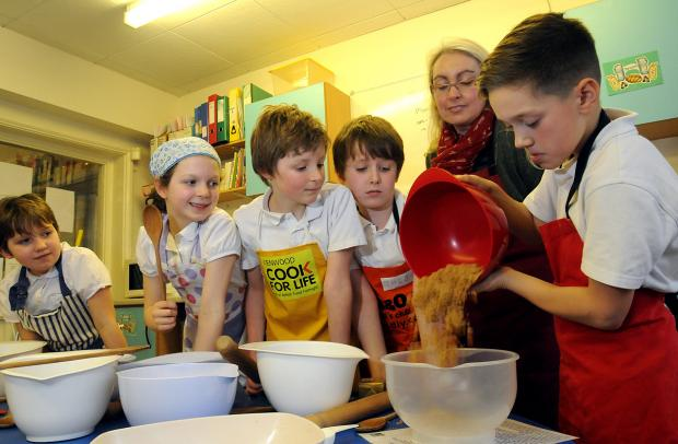 Making biscuits in the kitchen of the Cook School at Hempland Primary School.