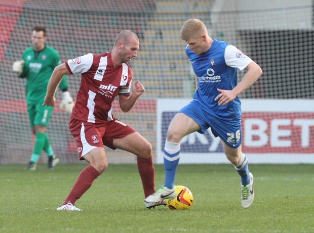 York City have confirmed the signing of Russell Penn, left, from Cheltenham