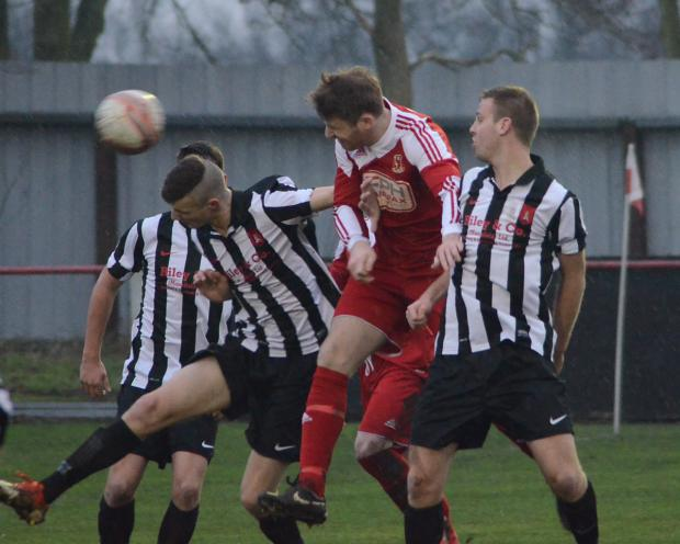Selby Town striker Danny Gray, centre, wins the b