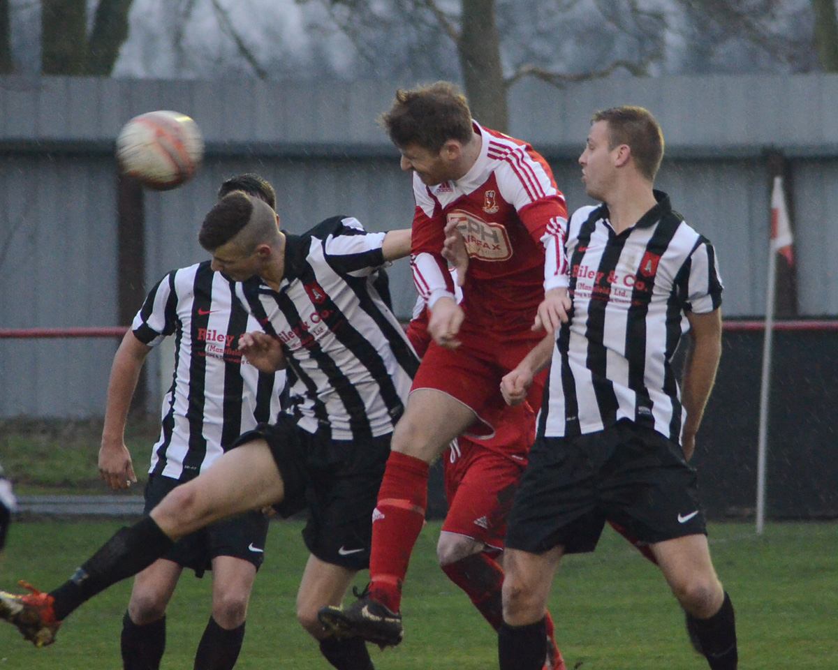 Selby Town striker Danny Gray, centre, wins the ball in the air against Clipstone, but his side lost the Northern Counties East  League  division one game 2-0  as new manager Jimmy Reid's reign at Flaxley Road  started with a defeat