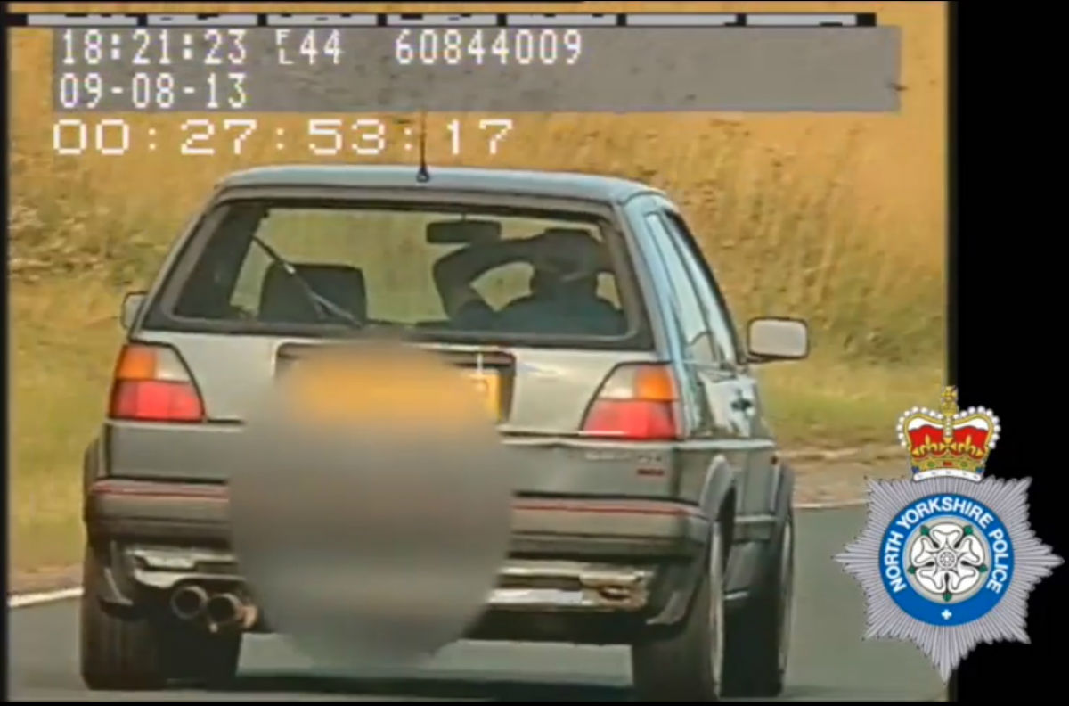 VIDEO: Motorist banned after caught driving with hands on head