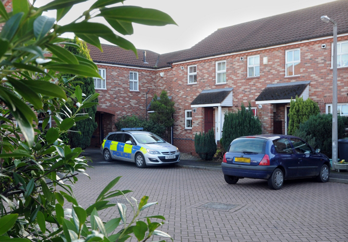 Police at the crime scene in Victoria Court on New Year's Day