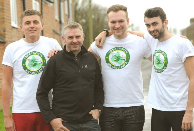 Derek Stainthorpe, second left, whose life was saved by the Great North Air Ambulance, and, from left, Liam Broadhead, Sam Harrison and Derek's son Connor, who are to run the York Marathon in aid of the service