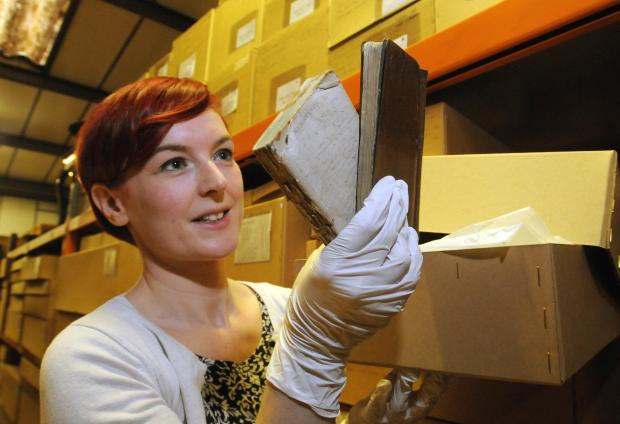 Katie Brown, assistant curator of history at the York Museums Trust, with the First World War diaries found in a store at the Castle Museum