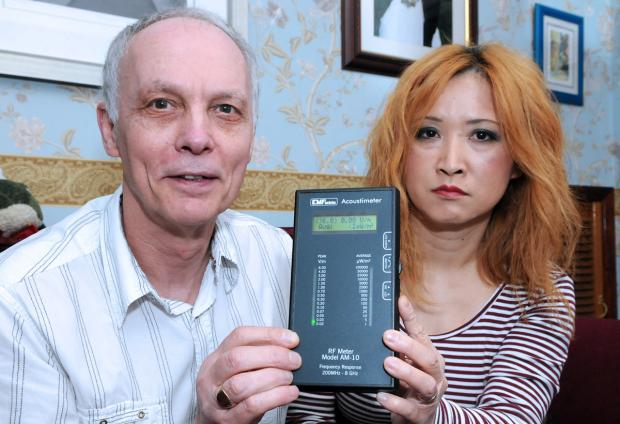 Paul and Keiko Croft, with some of the equipment they are using to monitor a nuisance noise at their home in Clay Place, Acomb