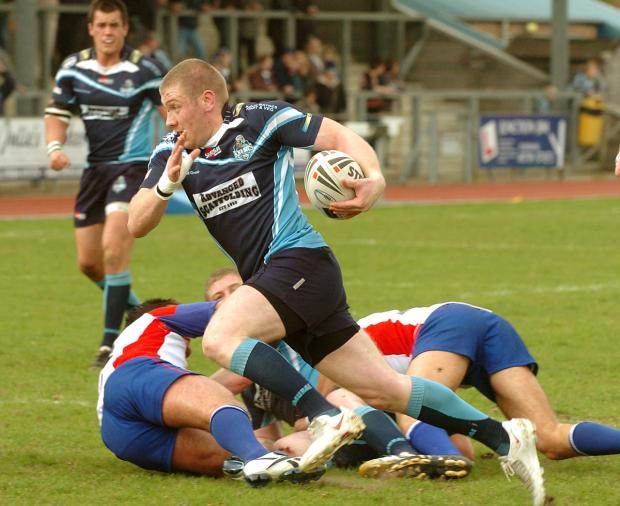 Paul March receives a pass from his brother David to score for the Knights against Rochdale