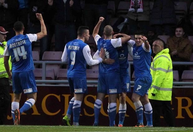 Ryan Bowman is mobbed after giving York City a 68th-minute lead at Northampton Town on Saturday