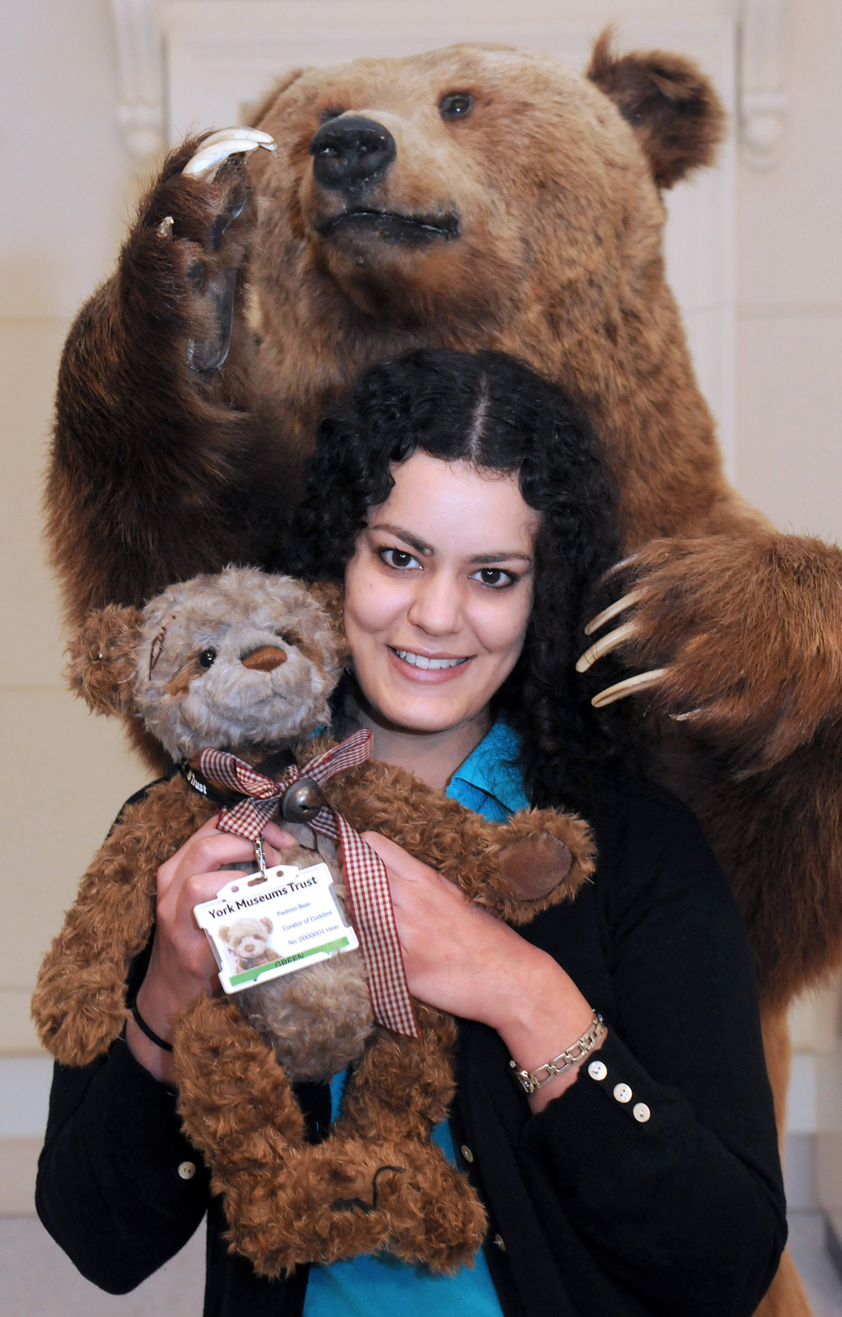 Rania Zein-Elabdin with the Yorkshire Museum's Padmin The Bear, and a brown bear from the taxidermy collection