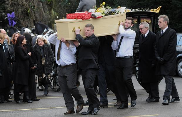 York Press: Mourners look on as the coffin of Lewis Thornton is carried into church