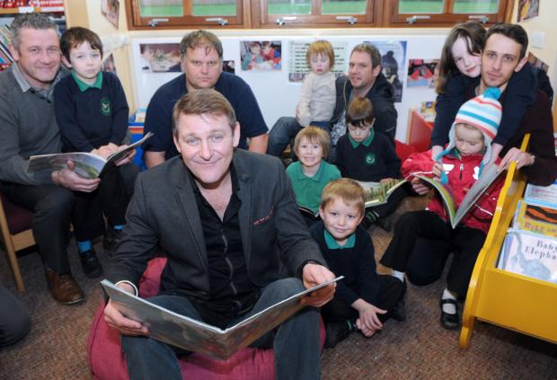 Actor Chris Walker, front, during the FRED event, with dads and children at Yearsley Grove School