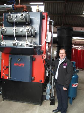 Simon Earley with the newly-installed Kalvis-MI biomass boiler