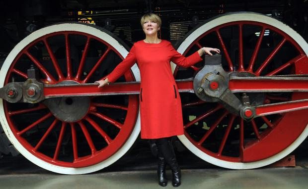 Jane Lady Gibson, chairman of Visit York, next to the Chinese locomotive KF7 at the National Railway Museum