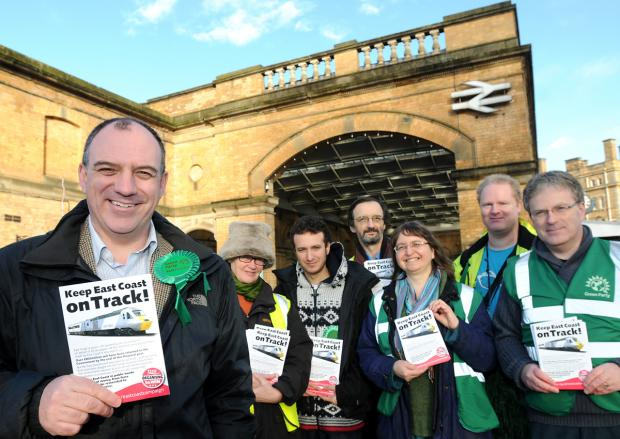 The Green Party Euro candidate, Councillor Andrew Cooper, left, and party members hand out leaflets at York Railway station
