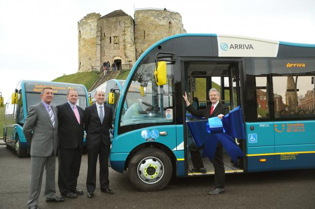 At the Eye of York with the new Arriva buses are, from left, Stuart Bear, Arriva Yorkshire's commercial manager, Mark Fenwick, Arriva's Selby depot manager, Andrew Bradley, York's sustainable transport manager and Coun Dave Merrett