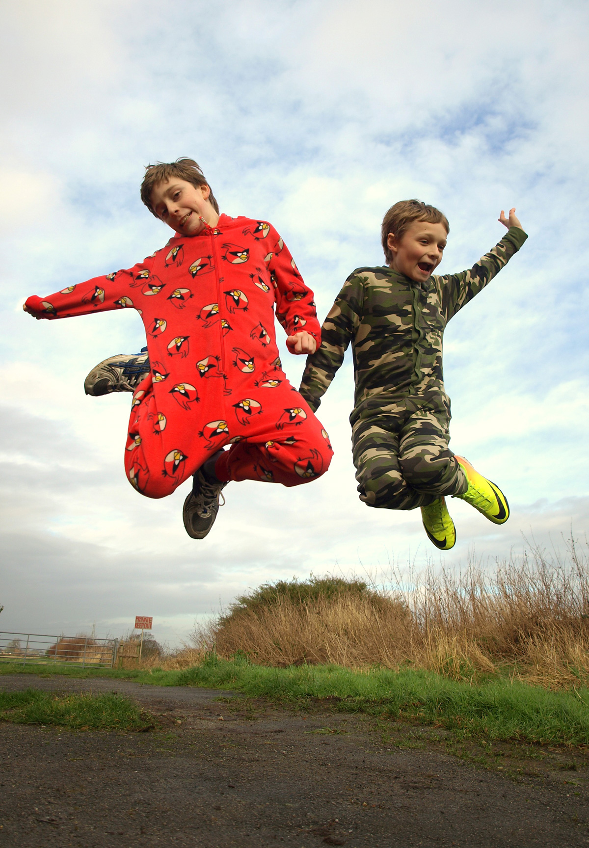 Elliot Ritchie, 12, left, and classmate Robert Gowland, 11, who are taking part in a sponsored 5k run in their onesies to raise money for Classrooms For Malawi