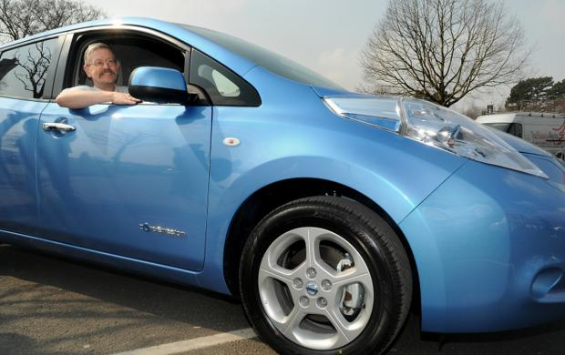 Coun Dave Merrett at the wheel of an  electric car in April last year