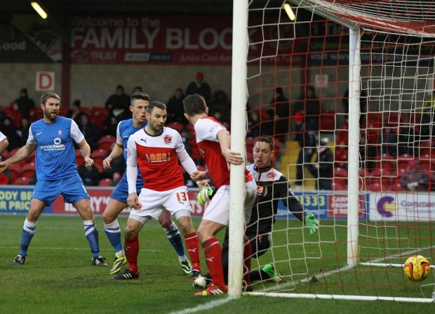 Will Hayhurst's wind-assisted corner is turned into the net by Fleetwood Town defender Conor McLaughlin. Picture: Gordon Clayton