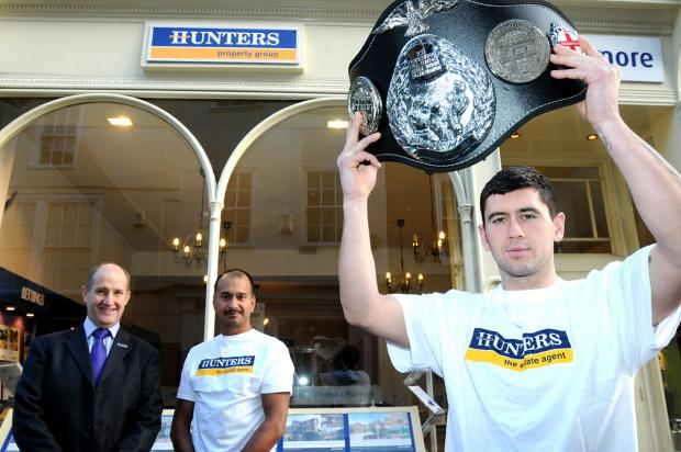 Stuart Phillips, the ICO professional full contact middleweight English champion, with, back, Kevin Hollinrake, managing director of Hunters, left, and Tony Dias