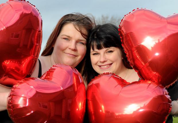 Annika Dowson, left, and Kerrianne Linning have enlisted the help of family and friends to pose with red balloons for a calendar to raise money for a bereavement unit at Scarborough Hospital's maternity suite