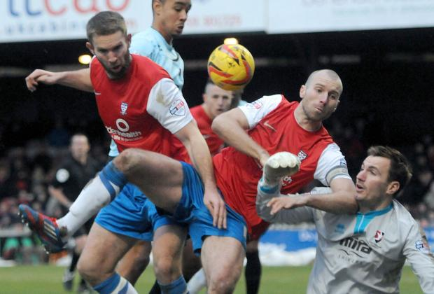 York City's Russell Penn, centre, and John McCombe, left, fail to find a way past Cheltenham 'keeper Scott Brown during Saturday's 0-0 Sky Bet League Two draw at Bootham Crescent