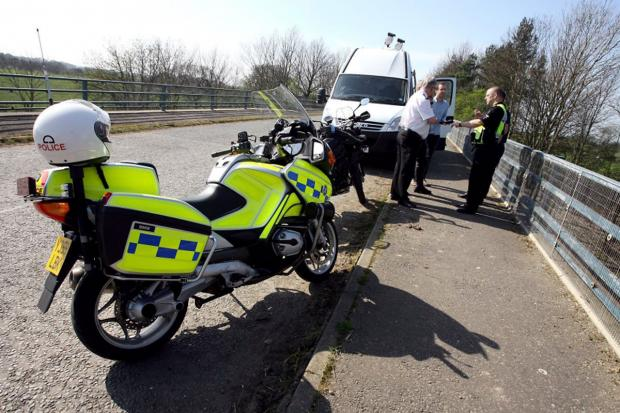Police on Tontine Bridge over the A19 near Crathorne using the Automatic Number Plate Recognition System to monitor traffic and travelling criminals