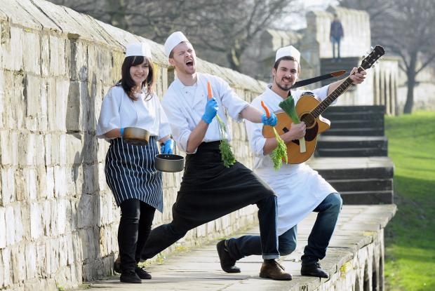 The Singing Chefs, from left, Ruby Clarke, Richard Wade and Chris Andrade, on the City Walls in York to  promote the Yorkshire Hotel Show at York Racecourse