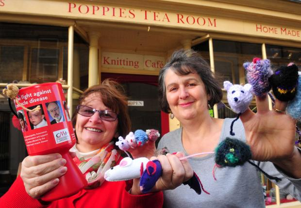 York Press: Tracy Bush and Anne Soper with some knitted mice and a CMA collection tin outside Poppies Tea Room, Pickering