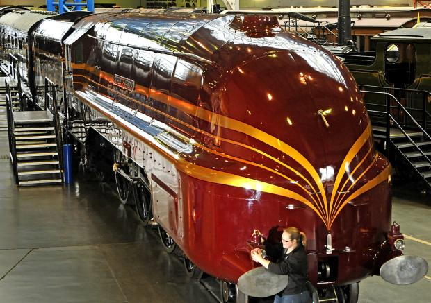 Naomi Collett, exhibitions officer at the National Railway Museum, with the Duchess of Hamilton locomotive at the museum