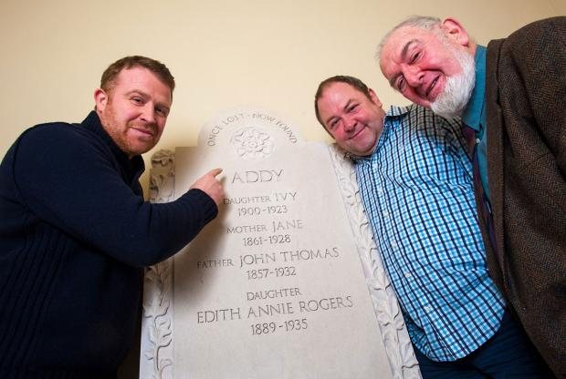 Adrian Buckley, left, of J Rotherham stonemasons, with Mark Addy, centre, and Mark's father, Ian, with the memorial stone which was hand- carved by the firm