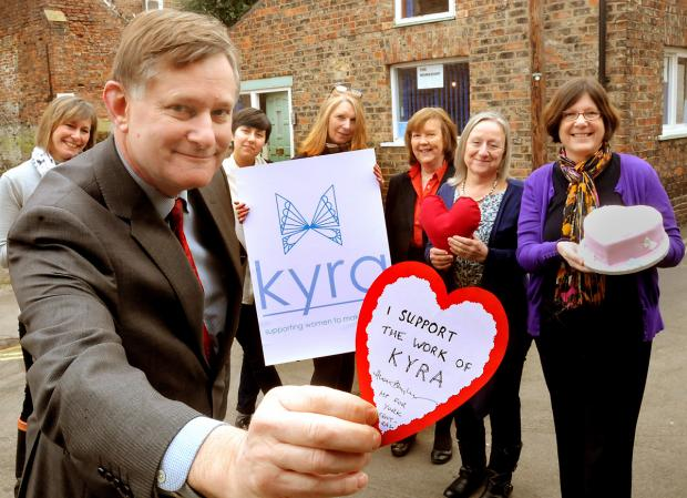 York Central MP Hugh Bayley signed a heart-shaped pledge of support when he visited the Kyra project. With Mr Bayley are project members, from left, Joy Herman, Heidi Chan, Glynis Werndly, Liz Leigh, Cath Nicholson and Yvonne Copley