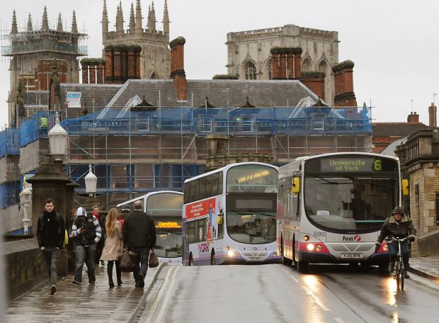 Buses traveling over Lendal Bridge in York